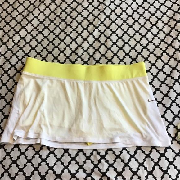 Nike Dresses & Skirts - Nike yellow and white tennis skirt w shorties 🤩